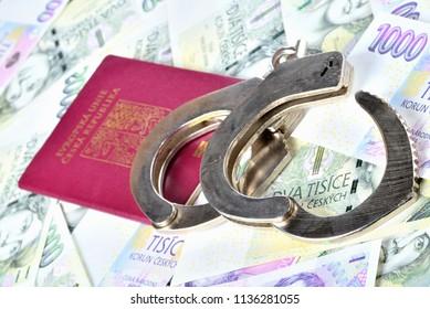 Czech republic passport and police handcuffs on banknotes - international arrest warrant concept
