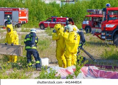 CZECH REPUBLIC, PLZEN, 4 JUNY, 2014: Fire departments and emergency teams in hazmat suits.