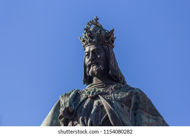 CZECH REPUBLIC, PRAGUE - 6 MAY: King Charles IV statue near Charles bridge in the City of Prague, Czech Republic.