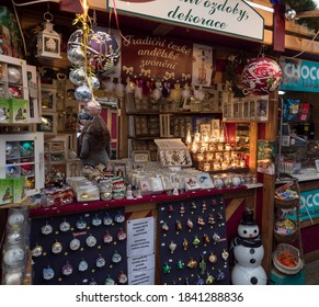 CZECH REPUBLIC, Prague, December 5, 2019: Traditional Christmas Market stall at Namesti Miru square selling homemade gifts, souvenirs, christmas decorations and toys.