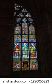 Czech Republic, Prague - June 30 2013: Colorful stained glass window in the cathedral of St. Vitus