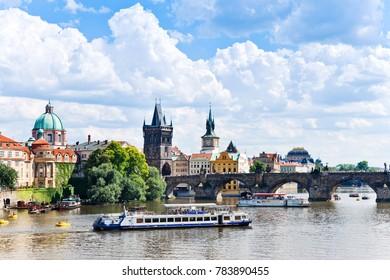 CZECH REPUBLIC, PRAGUE - MAY 4, 2015:  Charles bridge, Moldau river, Lesser Town, Prague (UNESCO), Czech republic - sightseeing cruisers on river