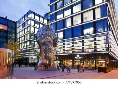 CZECH REPUBLIC, PRAGUE: NOV 14, 2017:  Franz Kafka statue by David Cerny, Poly-functional complex Quadrio (2013-14, Cigler Marani architects), Narodni trida, Prague, Czech republic