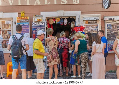 CZECH REPUBLIC, PRAGUE - SEPTEMBER 13, 2016: Photos of tourists close-up, standing near the entrance to the souvenir shop and the exchange office in Prague, the Czech Republic.