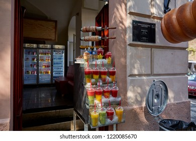 CZECH REPUBLIC, PRAGUE - SEPTEMBER 13, 2016: Multicolored smoothies stand near the cafe on the counter in Prague, the Czech Republic.
