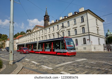 CZECH REPUBLIC, PRAGUE - SEPTEMBER 13, 2016: The red tram goes on the road from the cobblestones in Prague, the Czech Republic.