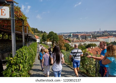 CZECH REPUBLIC, PRAGUE - SEPTEMBER 13, 2016: Photo of a group of tourists from the back going down the slope in Prague, the Czech Republic.