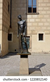 CZECH REPUBLIC, PRAGUE - SEPTEMBER 13, 2016: Bronze statue of a young man without clothes in full growth in Prague, Czech Republic.