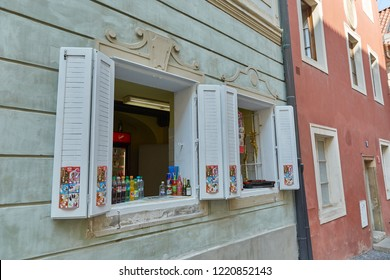 CZECH REPUBLIC, PRAGUE - SEPTEMBER 13, 2016: Cafe with drinks take-away with white shutters in Prague, Czech Republic.