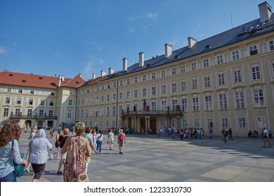 CZECH REPUBLIC, PRAGUE - SEPTEMBER 13, 2016: People are walking in the square near the administrative building in Prague, Czech Republic.