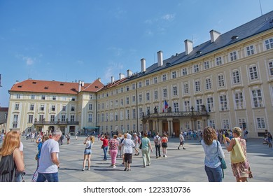 CZECH REPUBLIC, PRAGUE - SEPTEMBER 13, 2016: People are walking in the square near the administrative building on a bright sunny summer day in Prague, Czech Republic.