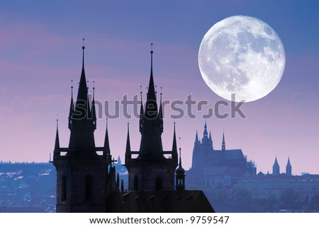 Czech Republic, Prague, silhouette of high section of Tyn church at night.