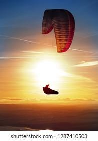 CZECH REPUBLIC, Rana - December 27, 2018: Paraglider on Gradient aspen6  flying over mountains at beautiful sunset, czech central mountains. Rana, Czech republic