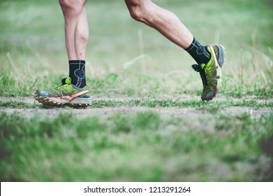 CZECH REPUBLIC, SLAPY, October 2018: Trail Maniacs Run Competition. Legs of the Runner in Yellow Green Salomon Running Shoes.
