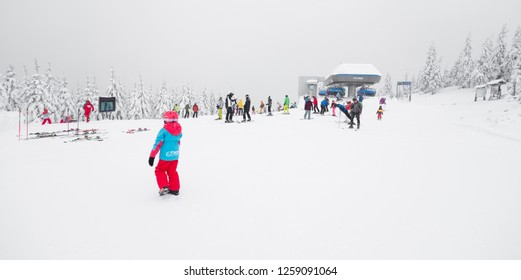 CZECH REPUBLIC, SPINDLERUV MLYN - December 15, 2018: Skiers on the upper cable car station of the Svaty Petr, resort Spindleruv Mlyn, Krkonose, Czech Republic