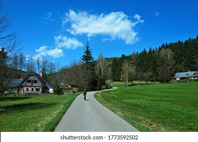 Czech Republic - view of a cyclist and a wooden house in the Antonina valley in the spring near the town of Svoboda - Shutterstock ID 1773592502