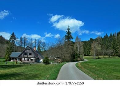 Czech Republic - view of wooden house in Antonin valley in spring near town Svoboda n / U - Shutterstock ID 1707796150