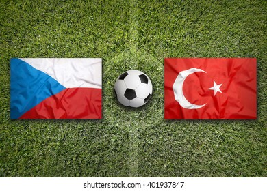 Czech Republic vs. Turkey flags on green soccer field