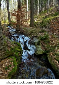 Czech Republic-view of Kalna brook with remnants of ice in spring near town Svoboda n  U - Shutterstock ID 1884988822
