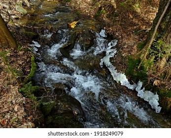 Czech Republic-view of Kalna brook with remnants of ice in spring near town Svoboda n U - Shutterstock ID 1918249079