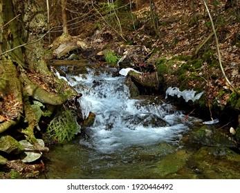 Czech Republic-view of Kalna brook with remnants of ice in spring near town Svoboda n U - Shutterstock ID 1920446492