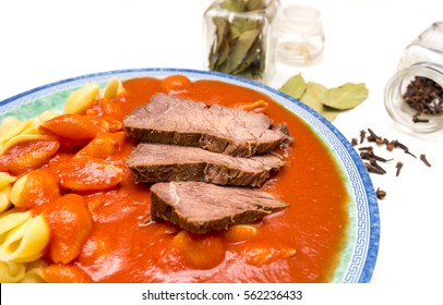 Czech traditional homemade food: Tomato sauce (Czech: rajska omacka) with pasta and beef meat - Shutterstock ID 562236433
