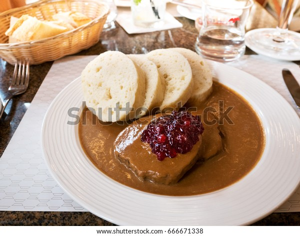 Czech Traditional Meal  - Dumplings with Sauce and Beef.