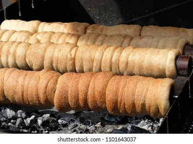 Czech traditional pastry baked over charcoal Trdelnik