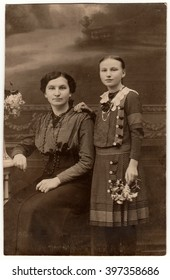 THE CZECHOSLOVAK REPUBLIC - CIRCA 1930s: Vintage studio photo shows mother and daughter. Black & white antique photography.
