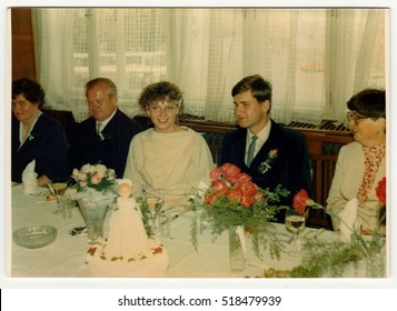 THE CZECHOSLOVAK REPUBLIC - CIRCA 1990s: Retro photo shows newlyweds and wedding guests during wedding feast (reception). Vintage color photography.