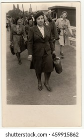 THE CZECHOSLOVAK REPUBLIC - MAY 1946: Vintage photo shows women go from the work.  Retro black & white photography.