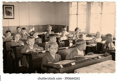 THE CZECHOSLOVAK SOCIALIST REPUBLIC - CIRCA 1950s: Retro photo shows pupils sit at the wooden school desks in the classroom.