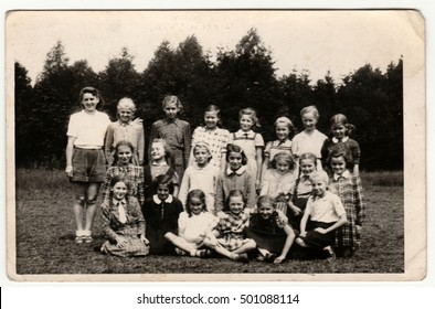 THE CZECHOSLOVAK  SOCIALIST  REPUBLIC - CIRCA 1950s: Vintage photo shows a group of girls (about ten years old) poses outdoors. Retro black & white  photography.