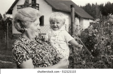 THE CZECHOSLOVAK SOCIALIST REPUBLIC - CIRCA 1950s: Vintage photo shows grandmother holds a small baby. Retro black & white  photography
