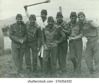 THE CZECHOSLOVAK SOCIALIST REPUBLIC - CIRCA 1970s: Retro photo shows young men (soldiers)  pose outdoors. Smiling soldiers. Vintage photography.