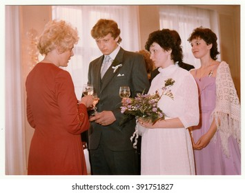 THE CZECHOSLOVAK SOCIALIST REPUBLIC - CIRCA 1980: Vintage photo shows wedding's celebratory drink after wedding ceremnony. Colour photography.