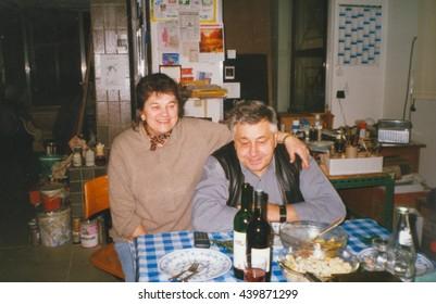 THE CZECHOSLOVAK SOCIALIST REPUBLIC - CIRCA 1980:  Retro photo shows elderly couple during rural party. Vintage color photography.