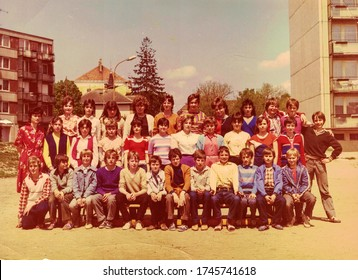 THE CZECHOSLOVAK SOCIALIST REPUBLIC - CIRCA 1980s: Retro photo of group of school pupils (teenagers) with their female teacher. Color photo