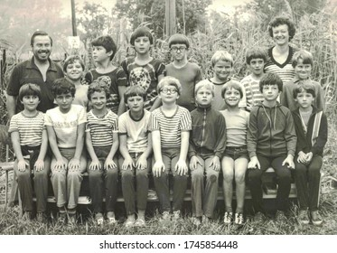 THE CZECHOSLOVAK SOCIALIST REPUBLIC - CIRCA 1980s: Retro photo of group of school pupils (young pioneers) with their teachers at summer camp. Black & white photo