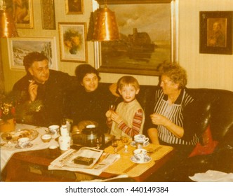 THE CZECHOSLOVAK SOCIALIST REPUBLIC - CIRCA 1980s:  Retro photo shows family during small home party in the living room. Vintage color photography.