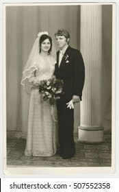 THE CZECHOSLOVAK SOCIALIST REPUBLIC - CIRCA 1980s: Vintage photo shows a bride with bridegroom. Bride wears  a soft veil and holds wedding flowers (bouquet). Retro black & white  photography.