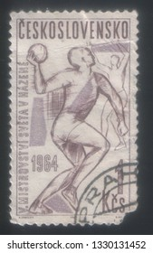 Czechoslovakia - 1964: The postage stamp of the republic of Czechoslovakia which depicts athletes who play volleyball.
