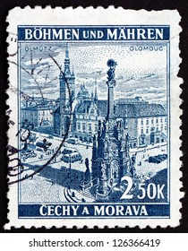 CZECHOSLOVAKIA - CIRCA 1939: a stamp printed in the Czechoslovakia shows Holy Trinity Column and Olomouc Town Hall, Town Square, Olomouc, Bohemia and Moravia, circa 1939