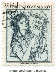 CZECHOSLOVAKIA - CIRCA 1954: A stamp printed in Czechoslovakia, shows a woman with a violin symbolizing music and spring, circa 1954