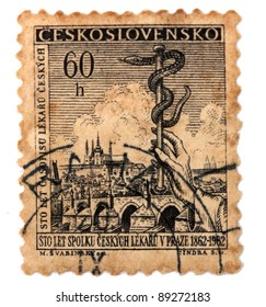 CZECHOSLOVAKIA - CiRCA 1962: A postage stamp was printed in Czechoslovakia, is devoted 100 years of union of doctors Prague shows the symbol of medicine , circa 1962