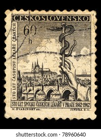 CZECHOSLOVAKIA - CIRCA 1962: A stamp printed in Czechoslovakia shows  image of Prague, a hand and a snake, circa 1962