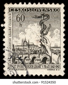 CZECHOSLOVAKIA - CIRCA 1962: A stamp printed in Czechoslovakia, shows snake as symbol of medicine (devoted 100 years of union of doctors Prague), series, circa 1962