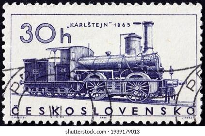 CZECHOSLOVAKIA - CIRCA 1966: a stamp printed in Czechoslovakia shows Karlstejn from 1865, locomotive, circa 1966