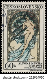 """CZECHOSLOVAKIA - CIRCA 1969: A stamp printed in Czechoslovakia shows women allegory """"Painting"""" by Alfons Mucha, circa 1969"""