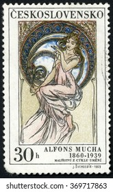 CZECHOSLOVAKIA - CIRCA 1969: stamp printed in Czech republic (Ceskoslovensko) shows music paintings by Alfons Mucha (1860-1939), woman in pink dress sitting on window; Scott 1634 A606 30h, circa 1969